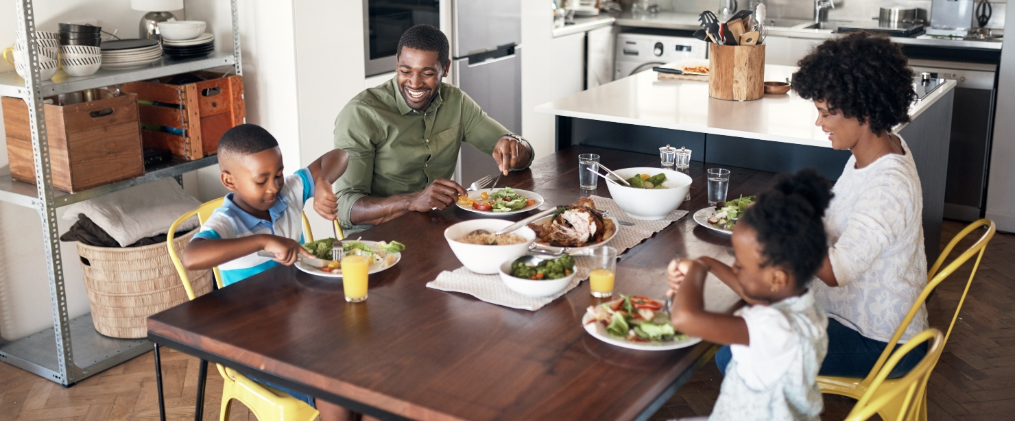 nutrient deficiencies: young Black family eating a meal together