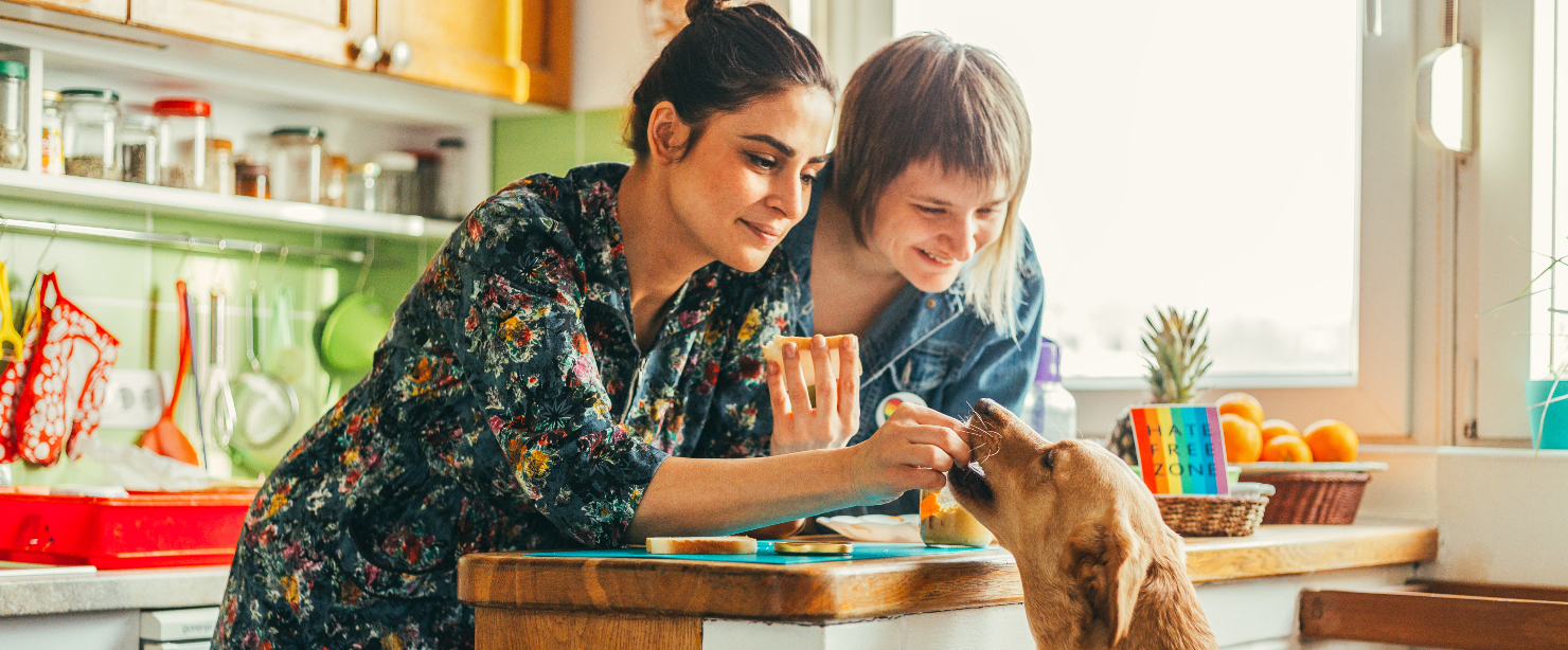 post-pandemic anxiety: two women in kitchen with dog