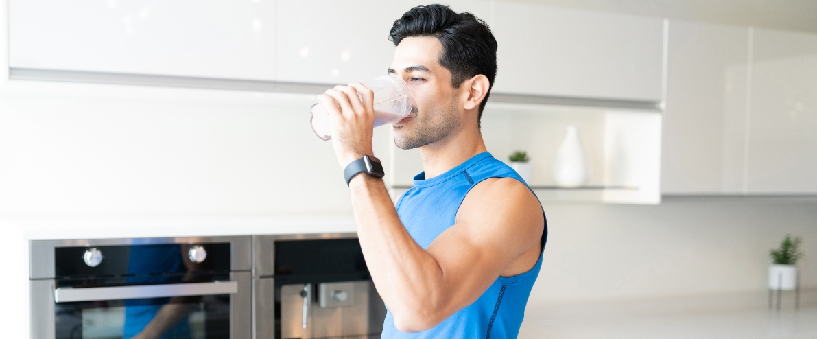 health and fitness myths: fit man drinking protein shake
