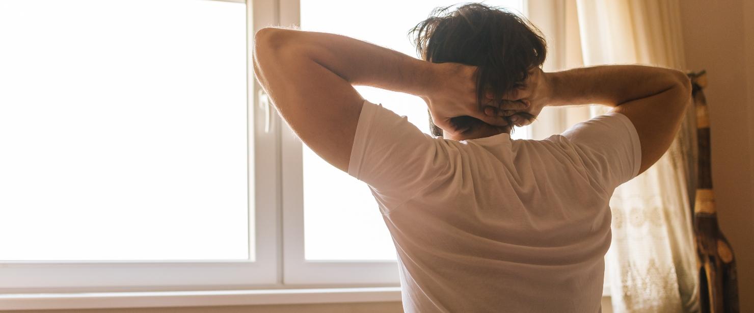 morning routine: man waking up to sunny windows